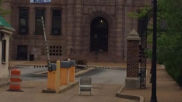 St. Louis City hall was evacuated early Tuesday morning after a suspicious container was found.