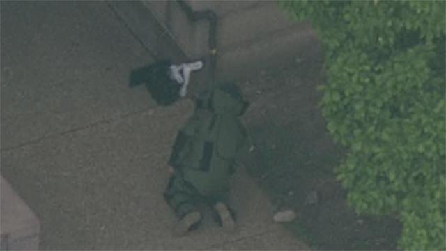 A bomb tech examined a bag outside St. Louis City Hall Tuesday