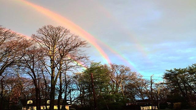 (Source: Twitter/ @amanda_curtis) Amanda Curtis took a picture of four rainbows in New York Tuesday.