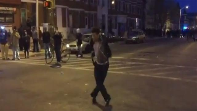 "(Credit: @ShomariStone) A Michael Jackson impersonator danced to ""Beat It"" Monday in Baltimore"