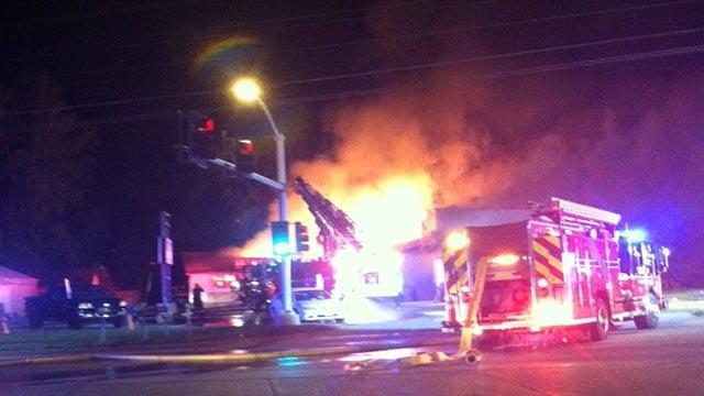 (Credit: O'Fallon Fire Department) the Fine Line Body Art Tattoo Shop caught fire in O'Fallon, Mo. Thursday
