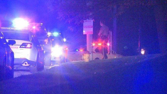 Police investigate a scene after responding to a disturbance call that lead to shots being fired.