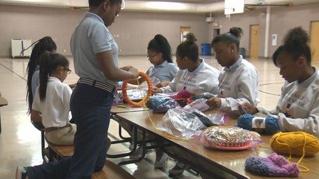 Students loom at De La Salle Middle School.