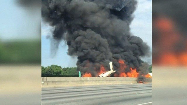 Four people die in plane crash on I-285 just north of Atlanta.