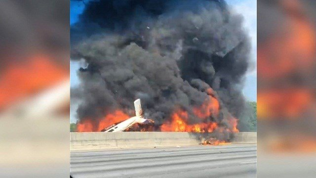 Four people die in plane crash on I-285 just north of Atlanta.