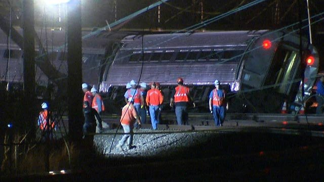 (Credit: CNN) Crews comb the scene after the Amtrak Northeast Regional train 118 traveling from Washington to New York derailed north of Philadelphia, Pennsylvania Tuesday evening, May 12, 2015.