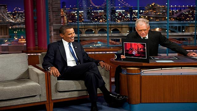(Credit: Pete Souza/White House photo) President Barack Obama reacts to a photograph of himself displayed by David Letterman during their interview at CBS studios in New York on September 21, 2009.
