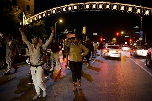 Protesters march down a street blocking traffic Thursday, Oct. 9, 2014, a day after Vonderrit D. Myers was shot and killed (AP Images)