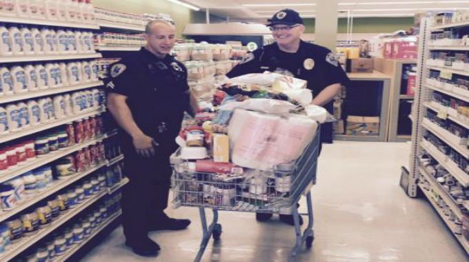 Cpl. Adam Randolph and David Tedrow fill a cart with items at Deal Mart (Courtesy: Chief Keith Grounsell)