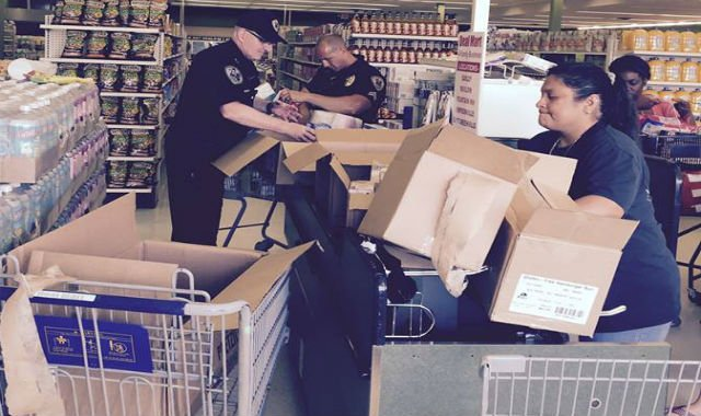 Cpl. Adam Randolph and David Tedrow purchase items at Deal Mart (Courtesy: Chief Keith Grounsell)