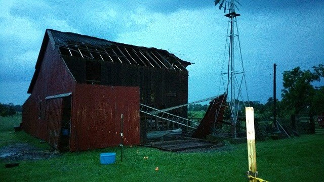 Storms caused damage to Myra Menjoulet's yard and barn southeast of Farmington.