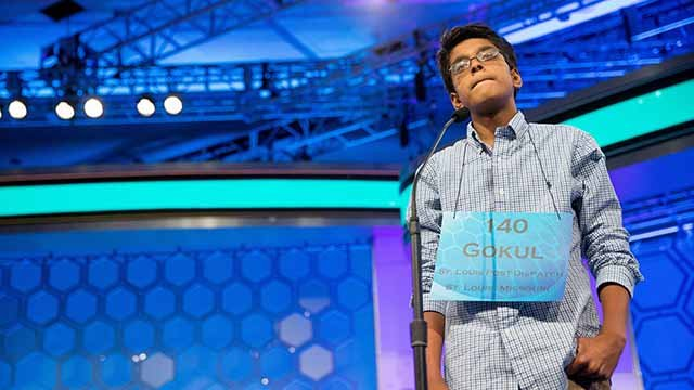 """Gokul Venkatachalam, 14, of St. Louis, Miss. stands on stage before correctly spelling """"bordereau"""" during the semifinals of the 2015 Scripps National Spelling Bee, Thursday, May 28, 2015, in Oxon Hill, Md"""