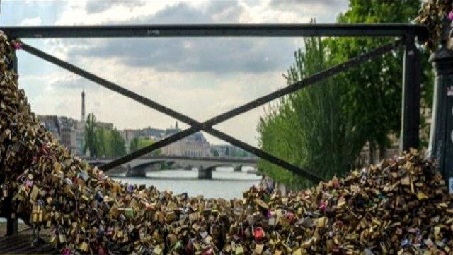 "The city of Paris will start removing padlocks from the Pont des Arts on Monday, effectively ending the tourist tradition of attaching ""love locks"" to the bridge."