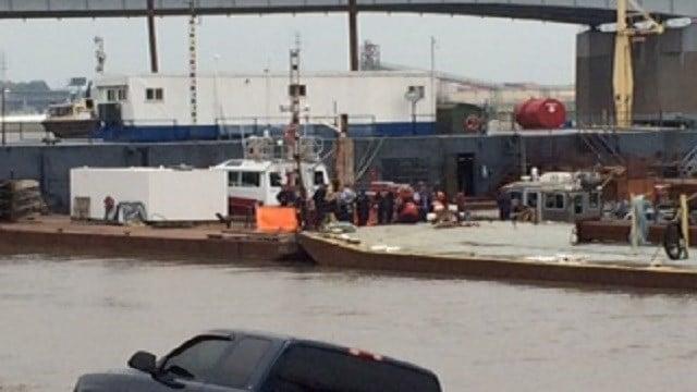 Investigators on the scene of a body found in the Mississippi River.
