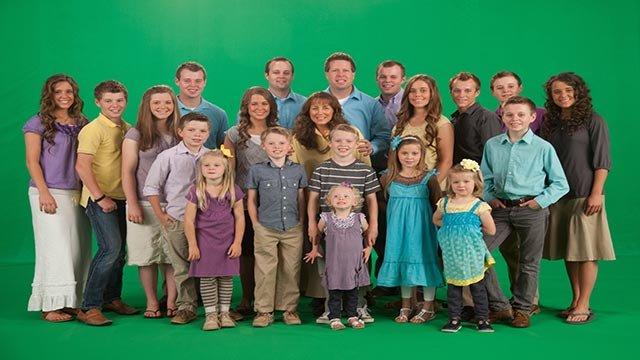 "(Credit: TLC) A photo of the Duggars from TLC's reality show ""19 Kids and Counting."""