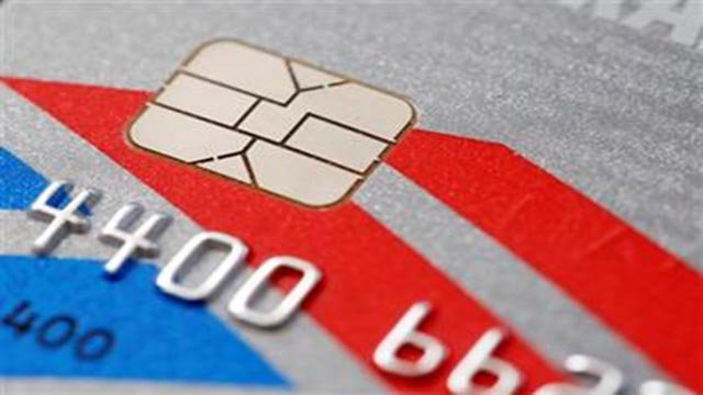 (AP Photo/Matt Rourke). This Wednesday, June 10, 2015 photo shows a chip-based credit card, in Philadelphia.