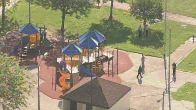 Investigators on the scene of a quadruple shooting on the playground at Rumbold Park.