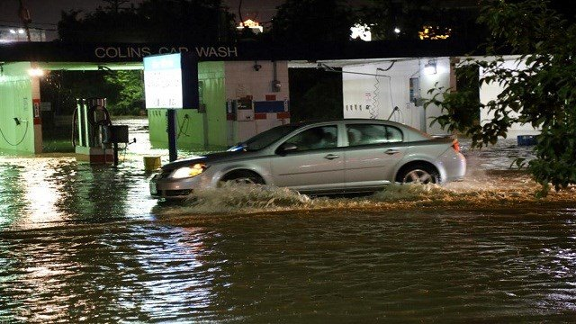 Flash flood waters covered Tenbrook Road in Arnold, Mo. Tuesday night, as people attempted to drive through the area.