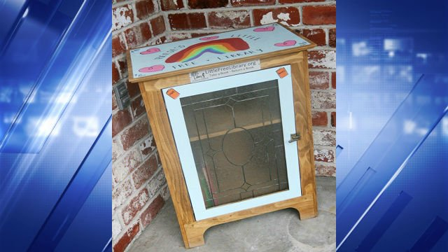 """The Short family's """"Little Free Library"""" on their front porch."""