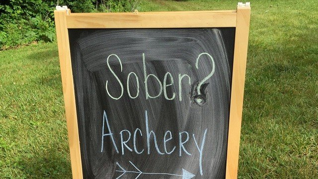 A helpful sign points the way to the camp's archery range.