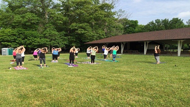 """Campers gather for Hangover Yoga on Friday and Saturday mornings at 9 a.m. """"Some say it's better than the hair of the dog!"""" says the camp website."""