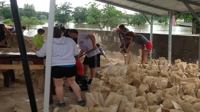 (Photo Credit: Karin Birmingham-Carter) Volunteers worked to fill sandbags in Herculaneum Friday