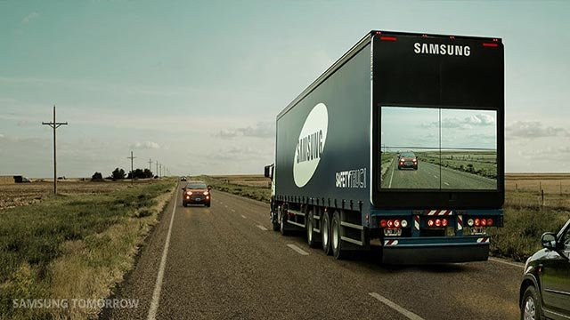 (Credit: Samsung)The Safety Truck prototype mounts a wireless camera on the front of the vehicle and livestreams the view onto a giant wall of four video screens on the back.