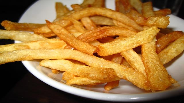 (Credit: CNN) French fries at restaurant Five Napkin Burger in New York, NY.