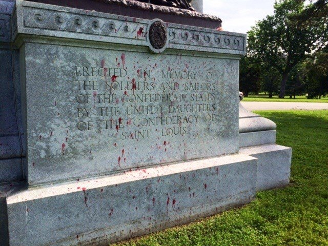 The back of the memorial the splattered with red paint