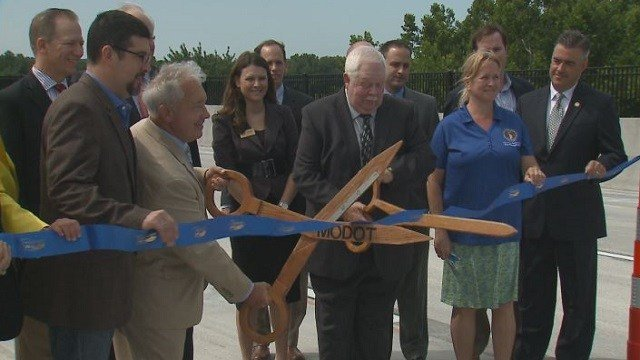 Officials celebrate the ribbon cutting on the new Boone Bridge.