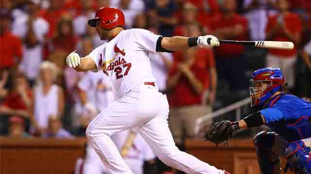 Jhonny Peralta #27 of the St. Louis Cardinals puts the ball in play to win the game on a throwing error in the tenth inning against the Chicago Cubs at Busch Stadium on June 26, 2015 in St. Louis, Missouri. The Cardinals beat the