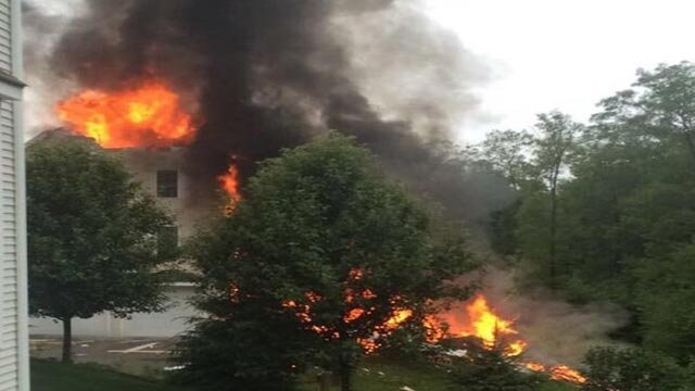 Three people were killed Sunday, June 28, 2015, after their small plane crashed into a home in Plainville, Massachusetts. The cause of the crash was not immediately clear (Credit: Twitter/@maryyorourke)