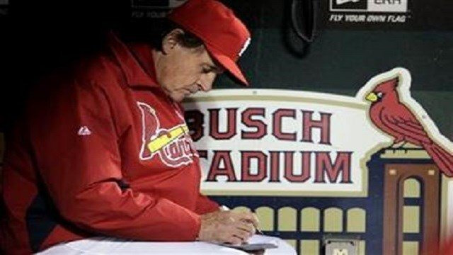 St. Louis Cardinals manager Tony La Russa writes some notes during the fifth inning of Game 6 of baseball's World Series against the Texas Rangers Thursday, Oct. 27, 2011, in St. Louis. (AP Photo/Charlie Riedel)