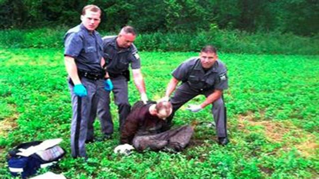 (AP Photo). Police stand over David Sweat after he was shot and captured near the Canadian border Sunday, June 28, 2015, in Constable, N.Y. Sweat is the second of two convicted murderers who staged a brazen escape three weeks ago