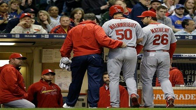 Adam Wainwright is helped off the field after getting injured while batting during the fourth inning of a baseball game against the Milwaukee Brewers Saturday, April 25, 2015, in Milwaukee. (AP Photo/Jeffrey Phelps)
