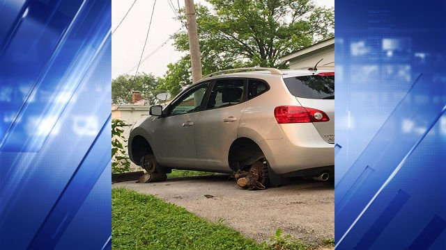 Logs were placed under the car's wheels after the tires and rims were stolen.