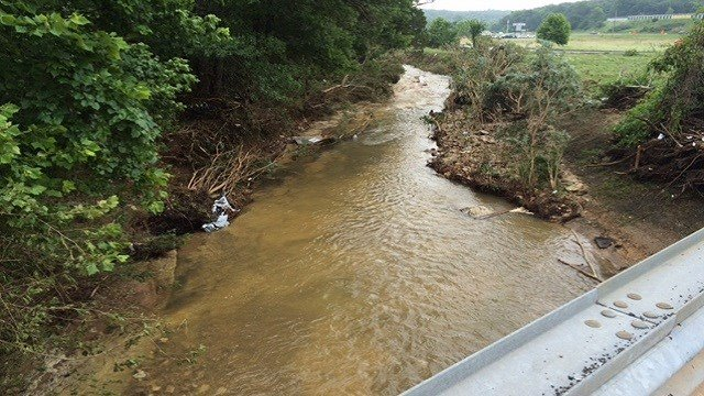 Officials search for missing persons following storms and flooding near Buck Creek.