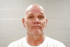 Kenneth Dufrenne, 58, is accused of putting six squared strips underneath three stamps on an envelope mailed to a Warren County Jail inmate last November.