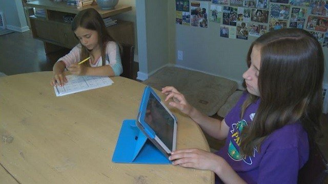 Children work on reading, math and writing during their summer break to avoid skills regression.