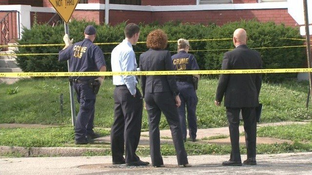 Detectives and prosecutors on the scene of a homicide.