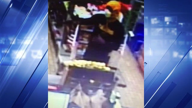 Surveillance footage shows a suspect robbing a 7-Eleven store at gunpoint. If you have any information on the suspect, call CrimeStoppers at 866-371-TIPS (8477).
