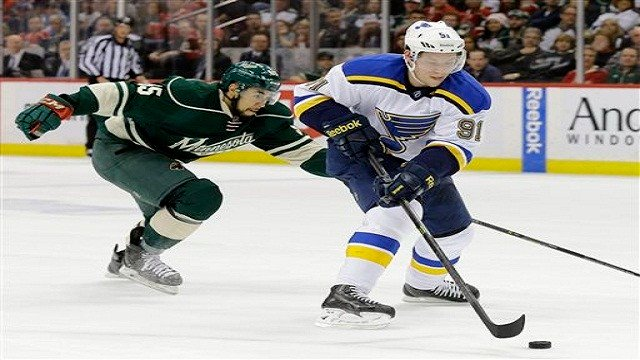St. Louis Blues right wing Vladimir Tarasenko controls the puck in front of Minnesota Wild defenseman Matt Dumba (55) during the second period of Game 4 of an NHL hockey first-round playoff series game in St. Paul, Minn. (AP Photos)