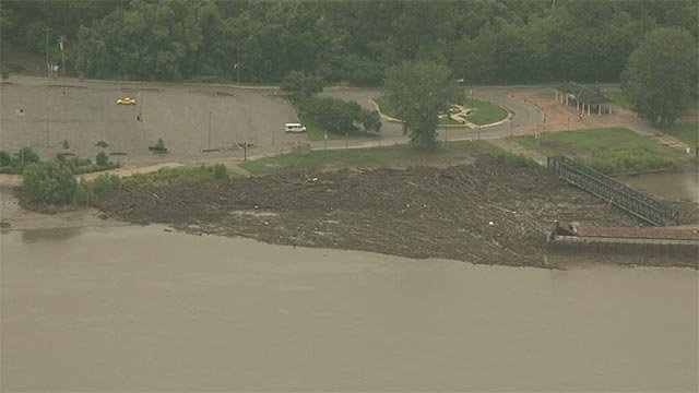 Debris building up along the St. Charles riverfront Wednesday morning