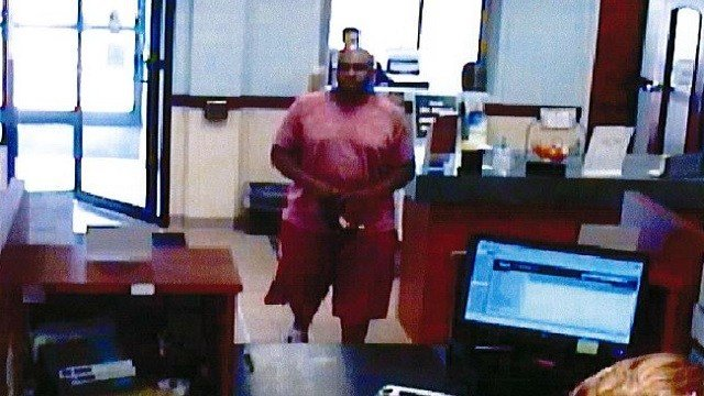The man in the picture is suspected of robbing Ozark Federal Saving Bank.