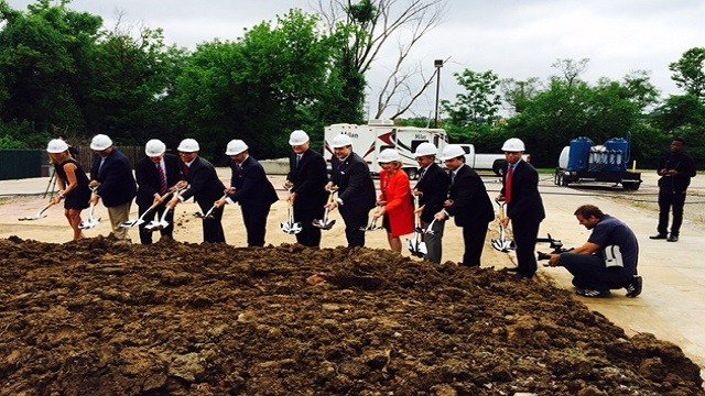 A groundbreaking ceremony took place at the site of the former burned QuikTrip, which will be home to a new Urban League center.