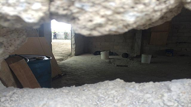 (Credit: Krupskaia Alis/CNN) This photograph shows the tunnel exit Guzman used to escape prison.
