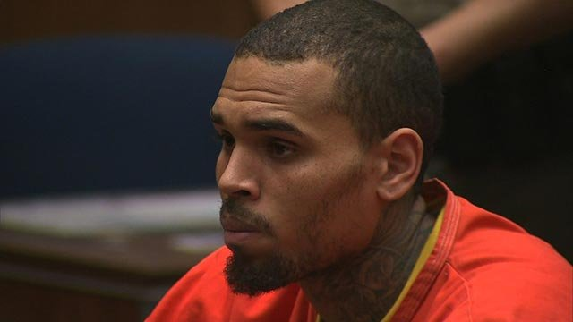 (Credit: POOL) Chris Brown appears in court on Monday, March 17, 2014, after being locked up in jail on a probation violation warrant the previous Friday.