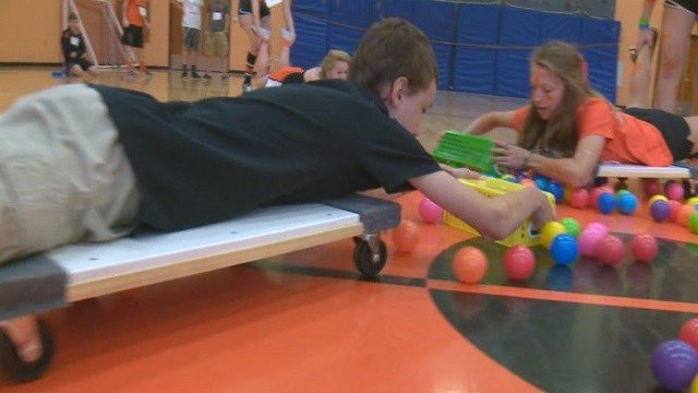 Incoming freshmen at Webster Groves High School play life-sized hungry hippos.