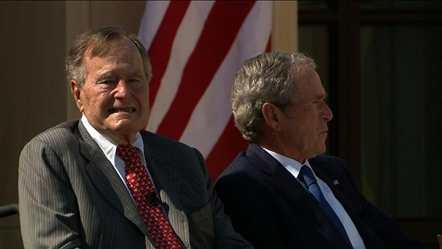 (Credit: POOL) Former Pres. H.W. Bush and son former Pres.George W. Bush Thursday, April 25, 2013 in Dallas at the ceremony for the George W. Bush Presidential Center.