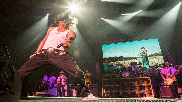 Kid Rock performs during the Cheap Date Tour 2015 at Aaron's Amphitheatre on Sunday, July 19, 2015, in Atlanta. (Photo by Robb D. Cohen/Invision/AP)